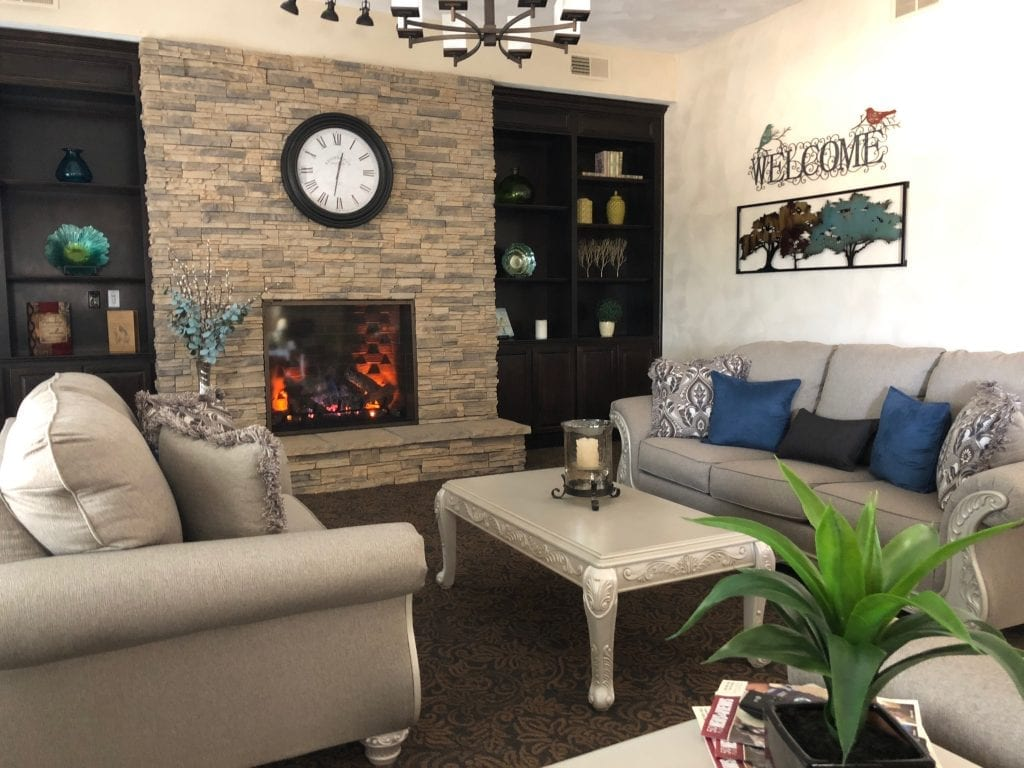 senior living fireplace lobby